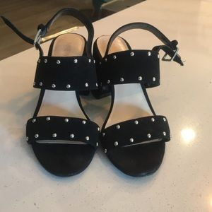 Never worn black studded strapped heels
